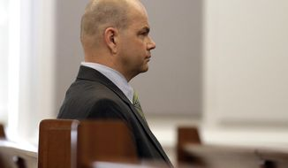 NFL agent Terry Watson listens at the Orange County Courthouse in Hillsborough, N.C., Monday, April 17, 2017. Watson faces numerous felony counts related to the football scandal at the University of North Carolina. Thirteen of the charges are for athlete-agent inducement related to gifts provided to former UNC football players Marvin Austin, Robert Quinn and Greg Little. (AP Photo/Gerry Broome)