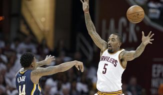 Indiana Pacers' Jeff Teague (44) passes over Cleveland Cavaliers' J.R. Smith (5) in the first half in Game 2 of a first-round NBA basketball playoff series, Monday, April 17, 2017, in Cleveland. (AP Photo/Tony Dejak)
