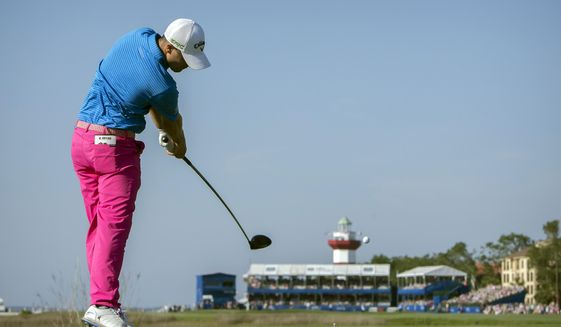 Wesley Bryan drives his ball off the 18th tee during the final round of the RBC Heritage golf tournament in Hilton Head Island, S.C., Sunday, April 16, 2017. (AP Photo/Stephen B. Morton)