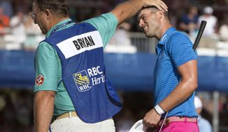 Wesley Bryan, right, is congratulated by his caddie William Lanier, left, after Bryan won the RBC Heritage golf tournament in Hilton Head Island, S.C., Sunday, April 16, 2017. (AP Photo/Stephen B. Morton)