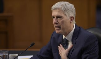 In this March 22, 2017 file photo, then-Supreme Court Justice nominee Neil Gorsuch testifies on Capitol Hill in Washington. It took less than 15 minutes for newly minted Justice Neil Gorsuch to ask his first questions from the bench. Gorsuch and his colleagues were hearing arguments Monday for the first time since President Donald Trump's pick was sworn in April 10. (AP Photo/Susan Walsh, File)