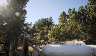 FILE - This Oct. 12, 2015, file photo shows the compound of a polygamist group in Pringle, S.D. A South Dakota lawmaker frustrated with what he views as inaction over the sect's outpost in his district wants legislators to look into the compound. (AP Photo/James Nord, File)
