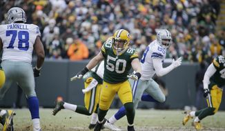 Green Bay Packers inside linebacker A.J. Hawk (50) works against the Dallas Cowboys during the second half of an NFL divisional playoff football game Sunday, Jan. 11, 2015, in Green Bay, Wis. (AP Photo/Nam Y. Huh) **FILE**