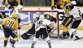 Nashville Predators left wing Filip Forsberg (9), of Sweden, celebrates after scoring a goal against Chicago Blackhawks goalie Corey Crawford during the third period in Game 3 of a first-round NHL hockey playoff series Monday, April 17, 2017, in Nashville, Tenn. Defending against Forsberg is Blackhawks' Duncan Keith (2).(AP Photo/Mark Humphrey)