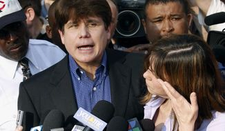 FILE - In this March 14, 2012, file photo, former Illinois Gov. Rod Blagojevich speaks to the media outside his home in Chicago as his wife, Patti, wipes away tears a day before reporting to prison after his conviction on corruption charges. An appeals court Tuesday, April 18, 2017, heard oral arguments on whether Blagojevich should get a third sentencing hearing. The hearing came more than five years after a lower court imposed a 14-year sentence on 18 corruption convictions. (AP Photo/M. Spencer Green, File)