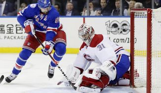 New York Rangers' Rick Nash (61) shoots the puck past Montreal Canadiens goalie Carey Price (31) for a goal during the second period of an NHL hockey game in Game 4 of an NHL hockey first-round playoff series Tuesday, April 18, 2017, in New York. (AP Photo/Frank Franklin II)