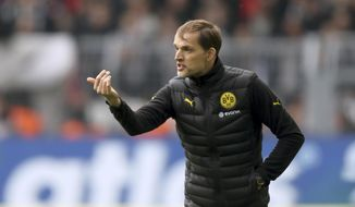 Dortmund coach Thomas Tuchel advises his team, during the German Bundesliga soccer match between Borussia Dortmund and Eintracht Frankfurt, in Dortmund, Germany, Saturday, April 15, 2017. (Ina Fassbender/dpa via AP)