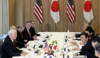 U.S. Vice President Mike Pence, left, and Japanese Deputy Prime Minister and Minister of Finance Taro Aso, third right, attend during Japan U.S. Economic Dialogue at the prime minister's office in Tokyo, Tuesday, April 18, 2017. (AP Photo/Eugene Hoshiko, Pool)