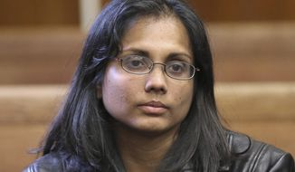 FILE - In this Nov. 22, 2013 file photo, former state chemist Annie Dookhan sits in Suffolk Superior Court in Boston. Dookhan pleaded guilty to tampering with evidence and falsifying thousands of tests in criminal drug cases, calling into question evidence used to prosecute the defendants. The state's highest court ordered the district attorneys in Massachusetts to produce lists by Tuesday, April 18, 2017, indicating how many of the approximately 24,000 tainted cases they would not or could not prosecute if new trials were ordered. (David L Ryan/The Boston Globe via AP, Pool, File)