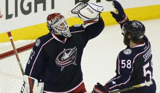 Columbus Blue Jackets' Sergei Bobrovsky, left, of Russia, and David Savard celebrate the team's 5-4 win over the Pittsburgh Penguins in Game 4 of an NHL first-round hockey playoff series Tuesday, April 18, 2017, in Columbus, Ohio. (AP Photo/Jay LaPrete)