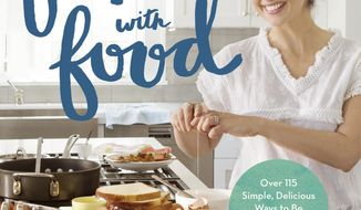 "This cover image released by Grand Central Life & Style shows ""Stirring Up Fun with Food: Over 115 Simple, Delicious Ways to Be Creative in the Kitchen,"" by Sarah Michelle Gellar and Gia Russo. (Grand Central Life & Style via AP)"