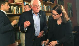 Former presidential candidate Bernie Sanders talks with Kentucky Coffeetree Cafe owner Mary Nishimuta on Tuesday, April 18, 2017, in Frankfort, Ky. Sanders is in a tour of Republican states in an attempt to energize Democratic voters. (AP Photo/Adam Beam)
