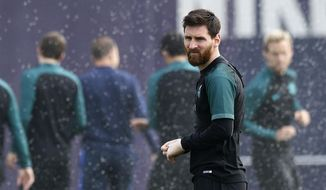 FC Barcelona's Lionel Messi looks on during a training session at the Sports Center FC Barcelona Joan Gamper in Sant Joan Despi, Spain, Tuesday, April 18, 2017. FC Barcelona will play against Juventus in a Champions League quarterfinal, second-leg soccer match on Wednesday .(AP Photo/Manu Fernandez)