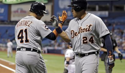 Detroit Tigers' Miguel Cabrera (24) celebrates with on-deck batter Victor Martinez (41) after Cabrera hit a home run off Tampa Bay Rays starting pitcher Matt Andriese during the first inning of a baseball game Tuesday, April 18, 2017, in St. Petersburg, Fla. (AP Photo/Chris O'Meara)