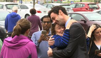 "In a Monday, March 27, 2017 photo, Democratic Congressional candidate Jon Ossoff greets supporters outside of the East Roswell Branch Library in Roswell, Ga., on the first day of early voting. President Donald Trump is attacking the leading Democratic candidate for a special election in a typically conservative Georgia congressional district, with Republicans bidding to avoid a major upset. On Twitter, Trump said Monday April 17, 2017, that ""The super Liberal Democrat in the Georgia Congressional race tomorrow wants to protect criminals, allow illegal immigration and raise taxes!"" (AP Photo/Alex Sanz)"
