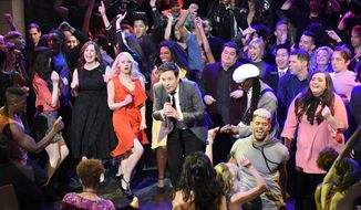 "In this April 15, 2017 photo released by NBC, host Jimmy Fallon, center, performs during the live opening number on ""Saturday Night Live,"" in New York. The network's telecast last weekend, with musician Harry Styles and  Alec Baldwin and Melissa McCarthy delivering their hit impersonations of Donald Trump and Sean Spicer, was seen by 7.87 million people this weekend, or 21 percent more than the previous week's telecast, the Nielsen company said. (Will Heath/NBC via AP)"