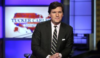 """Tucker Carlson, host of """"Tucker Carlson Tonight,"""" poses for photos in a Fox News Channel studio, in New York, March 2, 2017. Fox News Channel says """"Tucker Carlson Tonight"""" will begin airing an hour earlier to fill the time slot vacated by Bill O'Reilly, who lost his job Wednesday after allegations that he sexually harassed women. (AP Photo/Richard Drew) ** FILE **"""