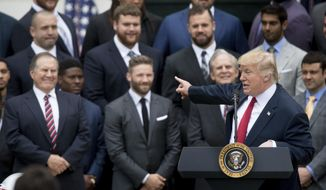 President Donald Trump points to New England Patriots head coach Bill Belichick, left, during a ceremony on the South Lawn of the White House in Washington, Wednesday, April 19, 2017, where he honored the Super Bowl Champion New England Patriots for their Super Bowl LI victory. (AP Photo/Andrew Harnik)