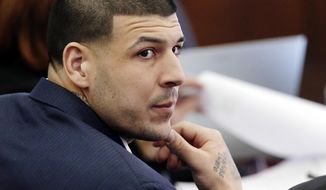 FILE - In this Wednesday, March 15, 2017, file photo, Defendant Aaron Hernandez listens during his double murder trial in Suffolk Superior Court, in Boston. Massachusetts prison officials said Hernandez hanged himself in his cell and pronounced dead at a hospital early Wednesday, April 19, 2017. (AP Photo/Elise Amendola, Pool, File)