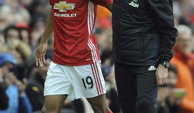 Manchester United's team manager Jose Mourinho, right, substitutes Manchester United's Marcus Rashford during the English Premier League soccer match between Manchester United and Chelsea at Old Trafford stadium in Manchester, Sunday, April 16, 2017.(AP Photo/ Rui Vieira)