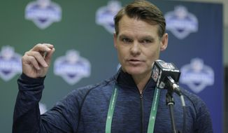 FILE - In this March 1, 2017, file photo, Indianapolis Colts general manager Chris Ballard speaks during a press conference at the NFL Combine in Indianapolis. Ballard has been busy this offseason. He's signed a dozen veteran free agents, re-signed a handful of his own players and pulled off a significant trade with New England. And he's not finished. (AP Photo/Michael Conroy, File)