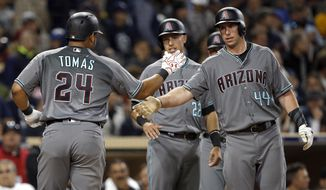 Arizona Diamondbacks' Paul Goldschmidt, right, congratulates Yasmany Tomas for hitting a three-run home run to score Jake Lamb, center, and Goldschmidt against the San Diego Padres during the fifth inning of a baseball game in San Diego, Tuesday, April 18, 2017. (AP Photo/Alex Gallardo)