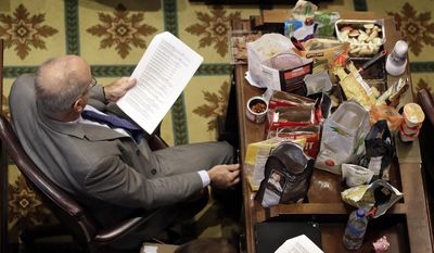 The desk of Rep. Roger Kane, R-Knoxville, is filled with snacks for members of the House of Representatives as they debate Gov. Bill Haslam's road and bridge funding bill Wednesday, April 19, 2017, in Nashville, Tenn. (AP Photo/Mark Humphrey)