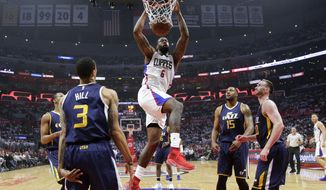 Los Angeles Clippers' DeAndre Jordan, center, dunks against the Utah Jazz during the first half in Game 2 of an NBA basketball first-round playoff series Tuesday, April 18, 2017, in Los Angeles. (AP Photo/Jae C. Hong)