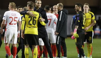 Dortmund's head coach Thomas Tuchel hugs Dortmund's Lukasz Piszczek after the Champions League quarterfinal second leg soccer match between Monaco and Dortmund at the Louis II stadium in Monaco, Wednesday April 19, 2017. Monaco beat Borussia Dortmund 3-1 to reach the Champions League semifinals. (AP Photo/Claude Paris)