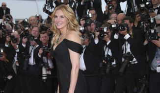 """In this Thursday, May 12, 2016, file photo, actress Julia Roberts poses for photographers upon arrival for the screening of the film """"Money Monster"""" at the 69th international film festival, Cannes, southern France. Roberts is more than just a """"Pretty Woman."""" People magazine has named her the """"World's Most Beautiful Woman"""" announced Wednesday, April 19, 2017. (AP Photo/Joel Ryan, File)"""