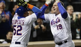 New York Mets' Jay Bruce (19) celebrates with Yoenis Cespedes (52) after Bruce hit a three run home run during the sixth inning of a baseball game, Wednesday, April 19, 2017, in New York. (AP Photo/Frank Franklin II)