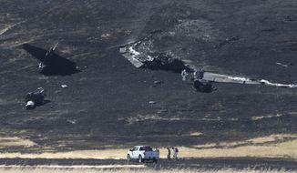 FILE - In this Sept. 20, 2016 file photo, a U.S. Air Force Hazmat team inspects the wreckage of a U.S. Air Force U-2 spy plane that crashed in the Sutter Butte mountains near Yuba City, Calif. The U.S. Air Force says pilot error forced two airmen to eject from a U2 spy plane while on a training mission from a Northern California base in September, killing one of them. The Air Force released findings of its probe of the crash near Sutter, Calif., on Wednesday, April 19, 2017. (AP Photo/Rich Pedroncelli, File)