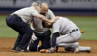 Detroit Tigers trainers assist shortstop Jose Iglesias after he was involved in a collision with Tampa Bay Rays' Brad Miller on grounder by Logan Morrison during the ninth inning of a baseball game Wednesday, April 19, 2017, in St. Petersburg, Fla. The Rays won 8-7. (AP Photo/Chris O'Meara)