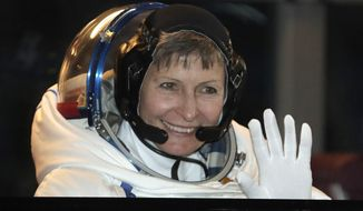 FILE - In this Nov. 17, 2016 file-pool photo, U.S. astronaut Peggy Whitson, member of the main crew of the expedition to the International Space Station (ISS), gestures from a bus prior the launch of Soyuz MS-3 space ship at the Russian leased Baikonur cosmodrome, Kazakhstan. President Donald Trump will speak next week to the commander of the orbiting International Space Station.White House spokesman Sean Spicer said Wednesday, April 19, 2017, the call with astronauts Peggy Whitson and Jack Fischer will take place on April 24. On that date, Whitson, the first woman to command the International Space Station, will have spent 535 days in space, the most time spent in space of any American astronaut.  (AP Photo/Dmitri Lovetsky, Pool, File)