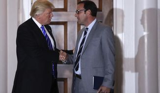 FILE - In this Nov. 19, 2016 file photo, then-President-elect Donald Trump shakes hands with Todd Ricketts at Trump's National Golf Club Bedminster clubhouse in Bedminster, N.J. Ricketts, President Donald Trump's pick for deputy commerce secretary has withdrawn from consideration.  (AP Photo/Carolyn Kaster, File)