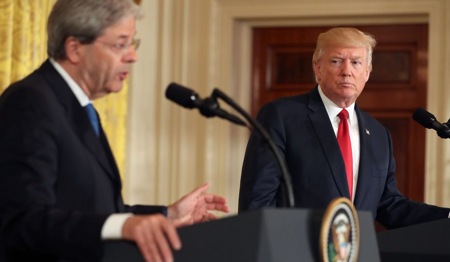 """President Donald Trump held a joint press conference with Italian Prime Minister Paolo Gentiloni on Thursday. Mr. Gentiloni urged Mr. Trump to play a bigger role in Libya after the defeat of the Islamic State. Mr. Trump disagreed saying, """"I don't see a role in Libya."""" Later he said, """"I see that as a primary role, and that's what we're going to do, whether it's in Iraq or in Libya or anywhere else."""" (Associated Press)"""