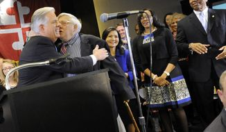 Maryland Gov.-elect Larry Hogan, left, a Republican, hugs his father, former U.S. Congressman Lawrence Hogan, second from left, after beating Democrat Anthony Brown, not pictured, in the state's gubernatorial race Wednesday, Nov. 5, 2014 in Annapolis, Md. Also standing on stage with Hogan are his wife Yumi, third from left, running mate Boyd Rutherford, right, and Rutherford's wife, Monica, second from right. (AP Photo/Steve Ruark)