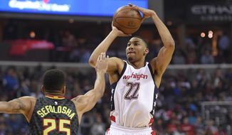 Washington Wizards forward Otto Porter Jr. (22) shoots against Atlanta Hawks forward Thabo Sefolosha (25), of Switzerland, during the first half in Game 2 of a first-round NBA basketball playoff series, Wednesday, April 19, 2017, in Washington. (AP Photo/Nick Wass)