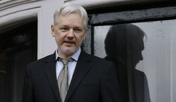 In this Feb. 5, 2016, file photo, WikiLeaks founder Julian Assange speaks from the balcony of the Ecuadorean Embassy in London. Two media reports say U.S. prosecutors are preparing or closely considering charges against the anti-secrecy group WikiLeaks, including  Assange, for revealing sensitive government secrets. (AP Photo/Kirsty Wigglesworth, File) **FILE**