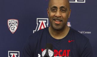 Lorenzo Romar answers questions during an NCAA college basketball press conference Thursday, April 20, 2017, at the University of Arizona in Tucson, Ariz. Romar, the former head men's basketball coach at the University of Washington, joined the staff of Arizona coach Sean Miller, who used to be one of his chief rivals.  (Courtney Talak/Arizona Daily Star via AP)