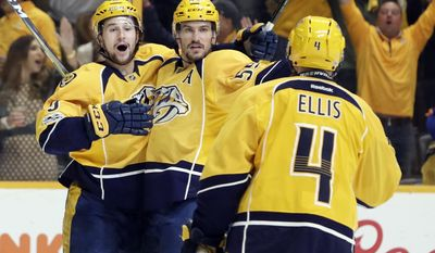 Nashville Predators defenseman Roman Josi (59), of Switzerland, celebrates with Filip Forsberg (9), of Sweden, and Ryan Ellis (4) after Josi scored against the Chicago Blackhawks during the second period in Game 4 of a first-round NHL hockey playoff series Thursday, April 20, 2017, in Nashville, Tenn. (AP Photo/Mark Humphrey)