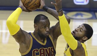 Cleveland Cavaliers' LeBron James keeps the ball from Indiana Pacers' Paul George during the first half in Game 3 of a first-round NBA basketball playoff series, Thursday, April 20, 2017, in Indianapolis. (AP Photo/Darron Cummings)