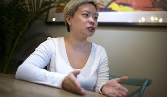 In this April 12, 2017 photo, Kerry Yang speaks about her struggles with depression during an interview in Beijing. Depression as an illness went widely unacknowledged for decades in China, even as the brutalities of the Cultural Revolution and, more recently, frenetic economic growth left emotional scars. Public attitudes shifted in recent years, propelled in part by the adoption of the nation's first mental health law five years ago. (AP Photo/Mark Schiefelbein)