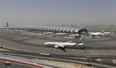 An Emirates plane taxis in front of terminal 3 at the Dubai International Airport in Dubai, United Arab Emirates, Thursday, April 20, 2017.  Tim Clark, the president of Emirates said the Mideast airline remains committed to the U.S. market despite plans to slash 20 percent of its flights in the wake of tougher U.S. security and visa measures. Clark told The Associated Press on Thursday that its cutbacks are temporary and it has no intention of pulling out of the 12 cities it currently flies to. (AP Photo/Kamran Jebreili)