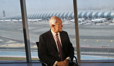 Emirates airline President Tim Clark talks to Associated Press reporter during an interview overlooking Dubai International Airport at the Emirates Airline Headquarter in Dubai, United Arab Emirates, Thursday, April 20, 2017. Clark said the Mideast airline remains committed to the U.S. market despite plans to slash 20 percent of its flights in the wake of tougher U.S. security and visa measures. Clark told The Associated Press on Thursday that its cutbacks are temporary and it has no intention of pulling out of the 12 cities it currently flies to. (AP Photo/Kamran Jebreili)