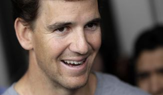 New York Giants quarterback Eli Manning talks to reporters during an availability ahead of the NFL Football draft, Thursday, April 20, 2017, in East Rutherford, N.J. (AP Photo/Julio Cortez)