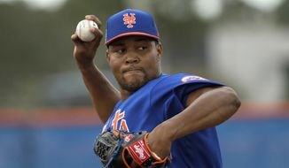 FILE - In this Feb. 21, 2017, file photo, New York Mets relief pitcher Jeurys Familia throws during a spring training baseball workout in Port St. Lucie, Fla. Familia returns to the Mets on Thursday, April 20, after sitting out the first 15 games of the season while serving a domestic violence suspension. (AP Photo/David J. Phillip, File)
