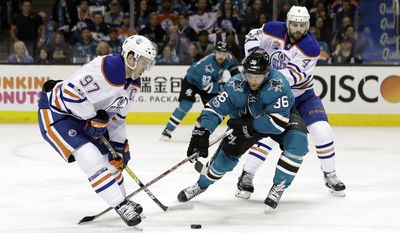 San Jose Sharks' Jannik Hansen (36) is defended by Edmonton Oilers' Connor McDavid (97) and Kris Russell (4) during the first period in Game 4 of a first-round NHL hockey playoff series Tuesday, April 18, 2017, in San Jose, Calif. (AP Photo/Marcio Jose Sanchez)