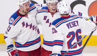 New York Rangers defenseman Brady Skjei (76) celebrates with Kevin Hayes (13) and Jimmy Vesey (26) after scoring against the Montreal Canadiens during the second period of Game 5 of a first-round NHL hockey Stanley Cup playoff series, Thursday, April 20, 2017, in Montreal. (Ryan Remiorz/The Canadian Press via AP)