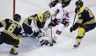 Boston Bruins goalie Tuukka Rask makes the save as Ottawa Senators left wing Clarke MacArthur (16) tries to poke the puck free during the first period of Game 4 of a first-round NHL hockey playoff series in Boston, Wednesday, April 19, 2017. (AP Photo/Charles Krupa)
